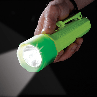 a glowing Pelican safety certified 2010PLY torch