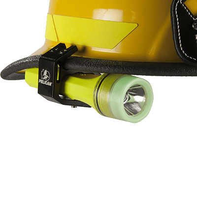 The 3325 explosion proof LED torch attached to a helmet hard hat