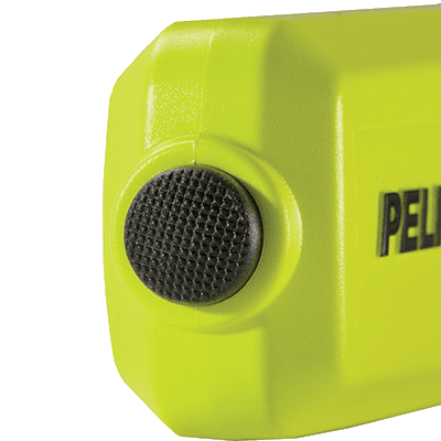 A rear view of the Pelican 3325 LED flashlight showing the push button tail switch